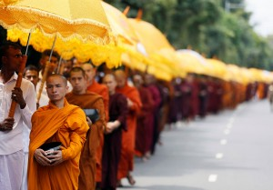 Buddhist monks walk down a road asking for alms during the annual Vesak festival, in Colombo